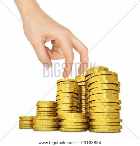 Womans hand with golden coins on white
