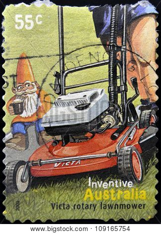 amp printed in Australia dedicated to australian inventions shows victa rotary lawnmower