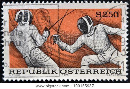 AUSTRIA - CIRCA 1974: A stamp printed in austria shows fencing