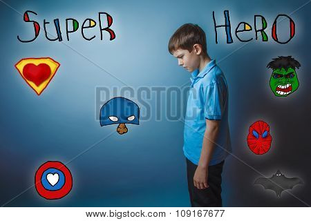 Teen boy bowed his head turned sideways and looking down superhe