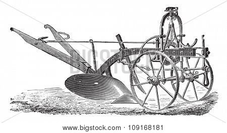 Wheeled plow with iron age, Didelot abbe, vintage engraved illustration. Industrial encyclopedia E.-O. Lami - 1875.