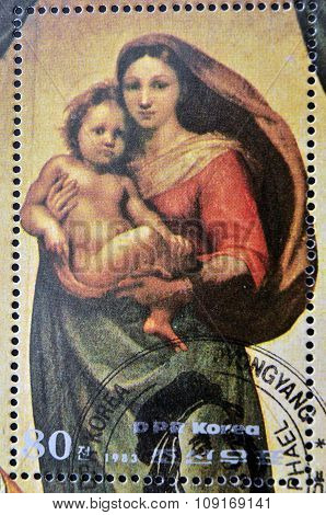 DPR KOREA - CIRCA 1983: A stamp printed in North Korea shows Sistine Madonna Painting by Raphael