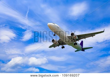 Landing plane in clouds