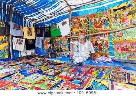 Handicrafts Are Perpared For Sale By Rural Indian Man And Child In Pingla Village, India