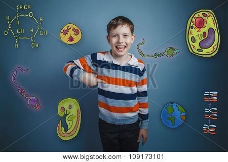 teenage boy laughing and pointing her finger down a set of icons