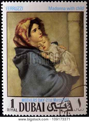 DUBAI - CIRCA 1968: A stamp printed in Dubai shows painting of Roberto Ferruzzi - Madonna with child