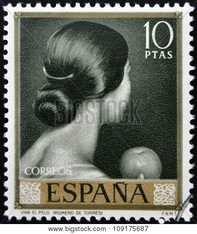 stamp printed in Spain shows painting of Back of woman's head by Romero de Torres