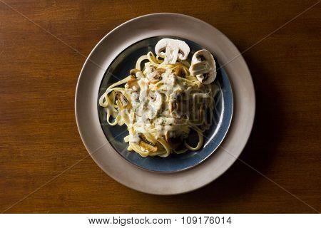 Fancy organic fetuccine pasta with creamy alfredo mushroom sauce