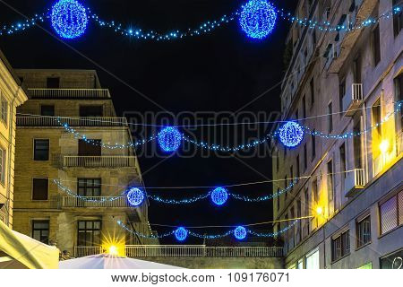 Light and Art in via Teofilo Rossi in Turin, Italy