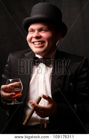 the young nice man in a black tuxedo