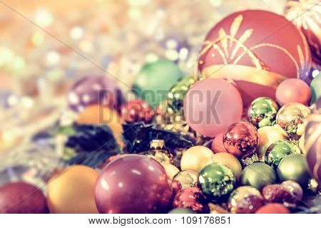 Christmas background with baubles and Christmas lights, shallow DOF, focus on the ball