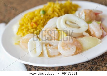 Chinese seafood medley of shrimp calamari and lobster with fried rice