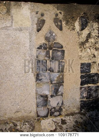 Ornamental flint in church wall