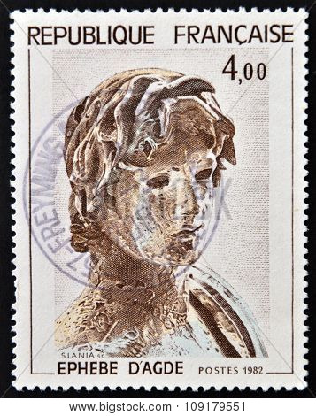 FRANCE - CIRCA 1982: a stamp printed in France shows Young Greek Soldier Hellenic Sculpture Agude