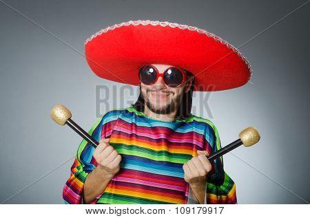 Man wearing sombrero singing song