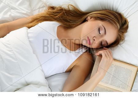 Young Beautiful Blonde Woman Portrait Lying In Bed Sleeping On Book