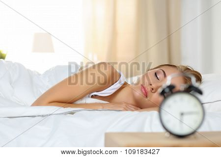 Beautiful Blonde Woman Peacefully Lying In Bed Sleeping