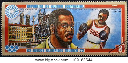 EQUATORIAL GUINEA - CIRCA 1972: A stamp printed in Equatorial Guinea shows boxer J. Fraziercirca 197