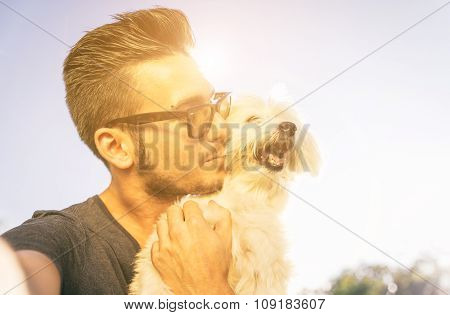 Young Man Taking Selfie With His Cute Dog Outdoor