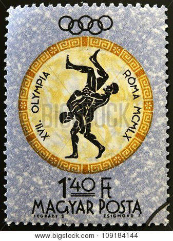 A stamp printed in Hungary shows fighters devoted to the Olympic games in Rome