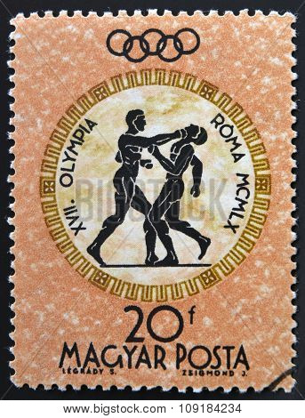 A stamp printed in Hungary shows boxing devoted to the Olympic games in Rome