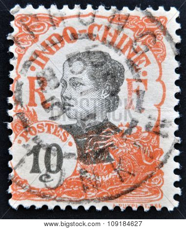 INDOCHINA - CIRCA 1907: A stamp printed in Indochina shows Annamite girl circa 1907.