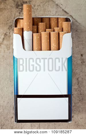 Pack Of Cigarettes With Cigarettes Sticking Out