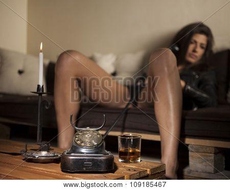 Sexy brunette girl in vintage interior