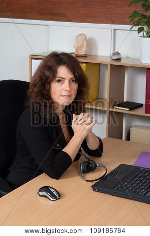 Businesswoman In Office Working At Her Desk