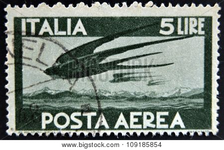 ITALY - CIRCA 1945: stamp printed in Italy shows Swallows in Flight circa 1945