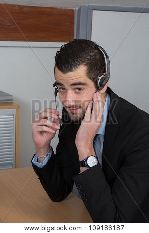 Happy Businessman In The Office On The Phone, Headset,  Looking Camera