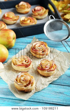 Fresh Puff Pastry With Apple Shaped Roses On Blue Wooden Table