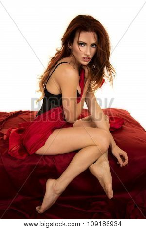 Red Head Woman Sitting Wrapped In Red Sheet Legs Down