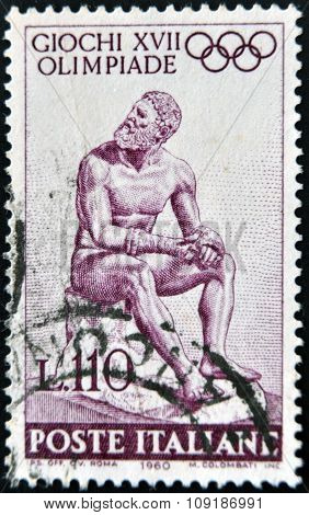 ITALY - CIRCA 1960: stamp printed in Italy shows Statue of the Seated boxer circa 1960