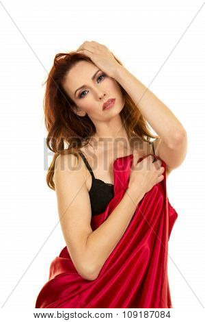 Red Head Woman Wrapped In Red Sheet Serious