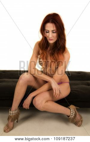 Woman Red Hair Bikini Sit On Black Bench Look Down