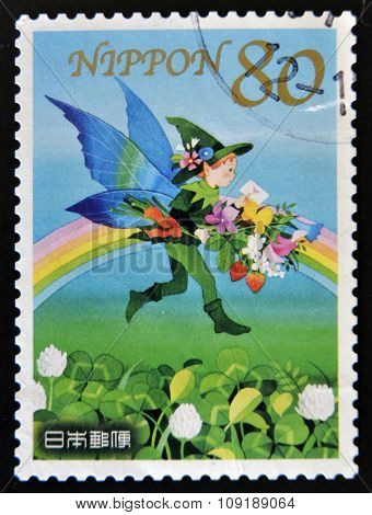 JAPAN - CIRCA 2011: A stamp printed in Japan dedicated to spring greeting shows elf with flowers