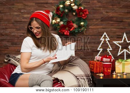 Pretty Hipster Woman Reading A Book