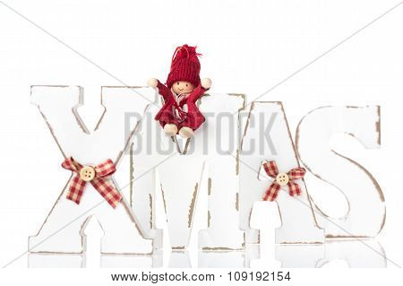 Wooden Letters Forming Word Xmas With Ribbons And Red Figures Besides Them