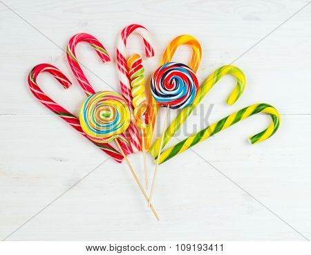 Colorful Candy On A White Wooden Background