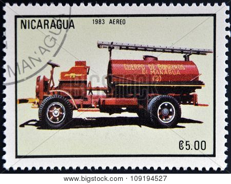 NICARAGUA - CIRCA 1985: stamp printed in Nicaragua shows old firetruck circa 1985.