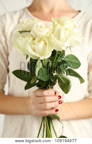 Female Hands Holding Bouquet Of White Roses