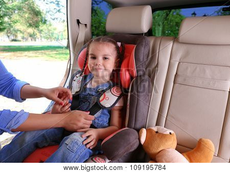 Cute little girl sitting in the car