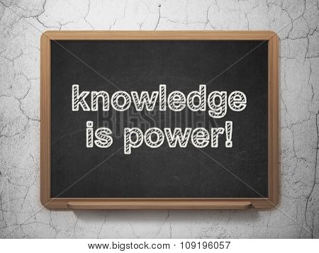 Studying concept: Knowledge Is power on chalkboard background