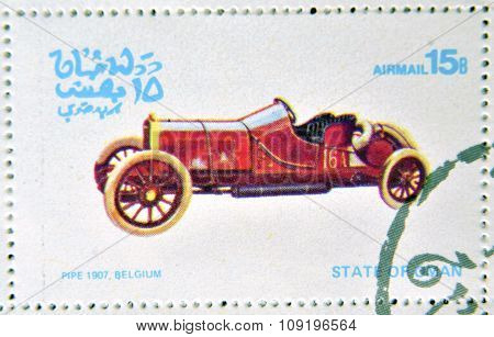 OMAN - CIRCA 1977: A stamp printed in State of Oman shows a old car Pipe 1907 Belgium circa 1977
