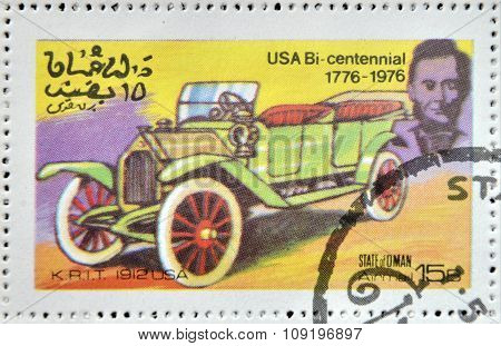 OMAN - CIRCA 1976: A stamp printed in State of Oman shows a american car K.R.I.T. 1912 usa