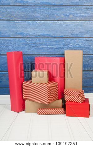 Christmas gifts in interior with wooden blue wall