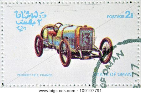 OMAN - CIRCA 1977: A stamp printed in State of Oman shows a old car Peugeot 1912 France circa 1977