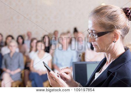 Public Speaker Is Texting