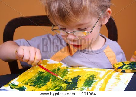 Young Boy Covered In Bright Paint